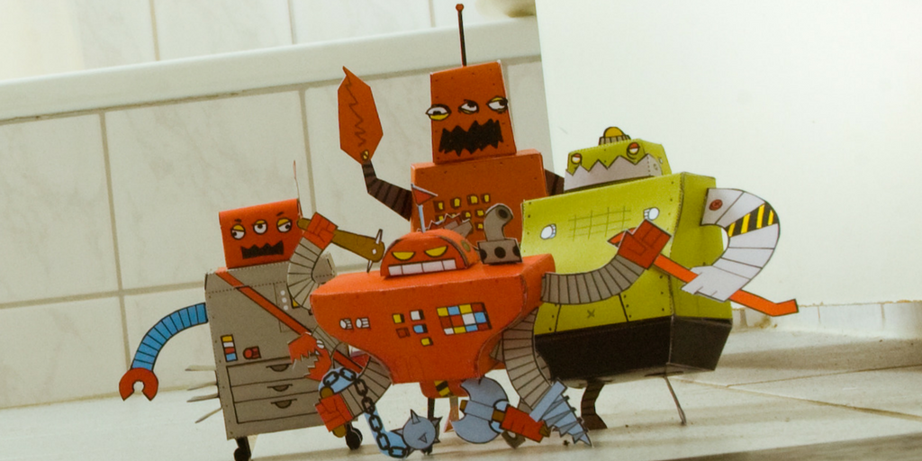 group of 4 toy bots with silly but sinister faces